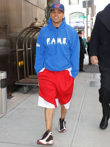 <p>Chris Brown caused controversy this week when he allegedly smashed a TV studio window in a rage when an interview didn't go quite as planned (don't mention to R word to him!). Here he is hours after, all smiles again</p>