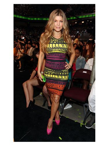 <p>The singer showed her colours in a punchy printed D&G dress which hugged her covetable curves</p>
