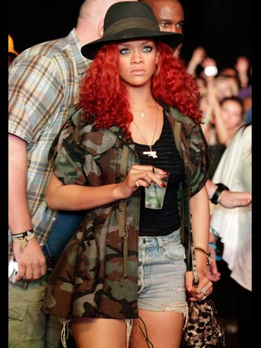 <p>Rihanna was pictured in the crowd taking cover in a camouflage jacket, khaki hat and the festival staple - shorts and vest combo</p>