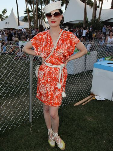 <p>Coachella's field location didn't put a stop to Dita's glamorous fashion personality but she did brighten up for the occasion with an unusually loud tangerine frock and lime espadrilles</p>