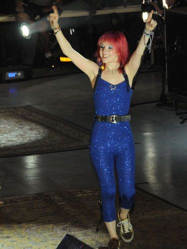 <p>Punk princess Hayley dressed down this eye-catching glitzy jumpsuit with a leather belt and a pair of trusty trainers</p>