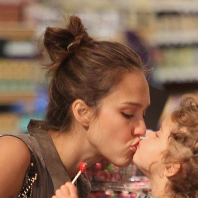 <p>Double sweet! Hands-on mum of the year (joint first with Jennifer Garner) Jessica Alba gave daughter Honor-Marie a lollipop and a peck on the lips while shopping for groceries in LA.</p>
