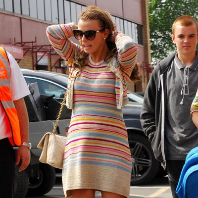 <p>Only a WAG would pair sky-scraper platforms with a demure little twinset. Coleen Rooney was on her way to see husband Wayne at Old Trafford, so not exactly a fashion show but still more interesting than football.</p>
