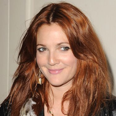 <p>Joining the red brigade is tress experimenter, Drew. She's cleverly coloured her formerly dip-dyed caramel locks a flaming auburn red which looks smoking hot against her pale complexion</p>