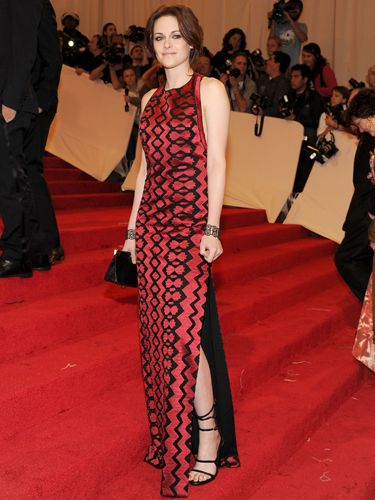 <p>Kristen chose Proenza Schouler for the big bash, wearing a printed red and black column dress by the design duo. A bold choice which may split opinion</p>