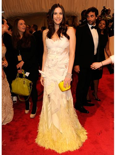 <p>Liv wore a gorgeous Givenchy Haute Couture by Riccardo Tisci gown which graduated from white to lemon yellow at the ostrich feather embroidered hem. A sunny delight!</p>