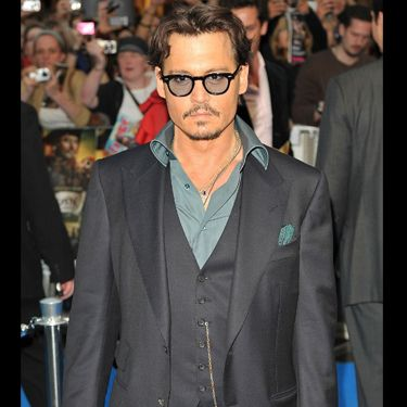 <p>No wonder our favourite man candy was greeted by screams from hundreds of female fans looking this hot in a charcoal suit and teal shirt. You certainly didn't disappoint us Mr. Depp!</p>