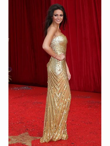 <p>Corrie's Tina McIntyre (Michelle Keegan) dazzled in a gold column dress - little wonder she won 'Sexiest Female' for the third time running!</p>
