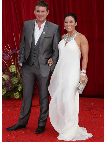 <p>Jessie Wallace went for a Grecian look in her flowing white frock by Tarvydas. Very pretty, but we wish she'd lose the hoops!</p>