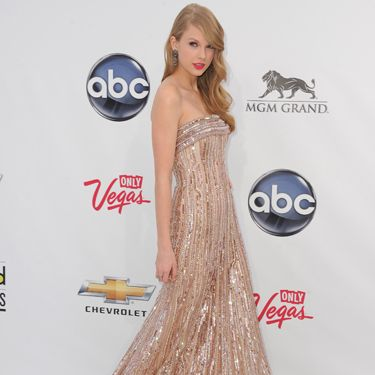 <p>The award winner wore a stunning beaded Elie Saab gown in a blush tone palette and kept accessories minimal with just some chandelier earrings complementing the dress</p>