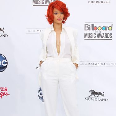 <p>She caused controversy snogging Britney on stage and with her look too – this white harem trouser suit by Max Azria had a feel of Whitney Houston to it. Eek!</p>