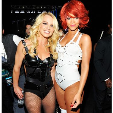 <p>Fresh from their 'S&M' performance, Brit and Ri posed backstage showing off their toned physiques in black and white pvc belted leotards and kinky boots</p>