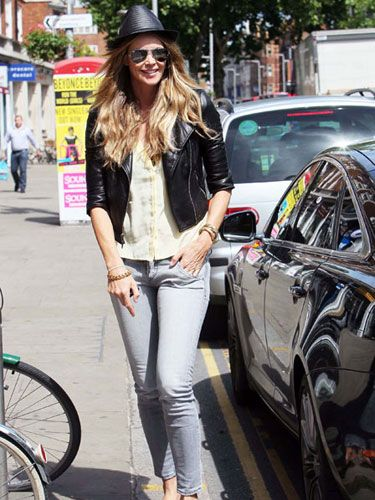 Elle Macpherson looked summery in a straw fedora and flip flops on a shopping trip in London's West End.