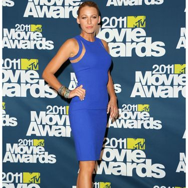 <p>Looking smoking hot as ever, Blake chose to pair a blue Michael Kors dress with killer Louboutin shoes in a clashing purple hue</p>