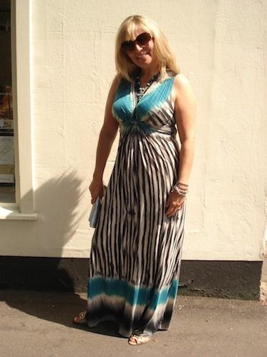 Sarah looked absolutely stunning in this figure-hugging maxi from Maille Demoselle (loyally purchased in her mum's shop), but it's the peeptoe Guccie wedges hidden underneath that really finish it off!