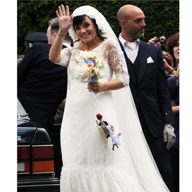 Lily was every inch the beautiful bride in a full-length lace dress created especially for her by French designer Delphine Manivet