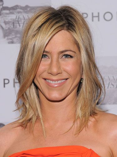 <p>Forever leading the way in celebrity hairstyle trends, when Jen An had her hair quite literally 'lobbed off', hairdressers around the world went on high alert. Now one of the most requested cuts of the summer, her relaxed way of wearing it, complete with off-centre parting gives it a tousled beachy twist</p>
