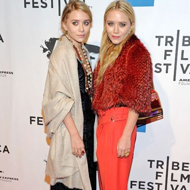 <p>There is much controversy surrounding Mary-Kate Olsen's layered looks, however there is no doubt that these bright orange trousers are essential to the colour trend. She balances the brightness of the trousers with a fabulous redish feathered jacket and simple black strapped shoes, mastering the look</p>