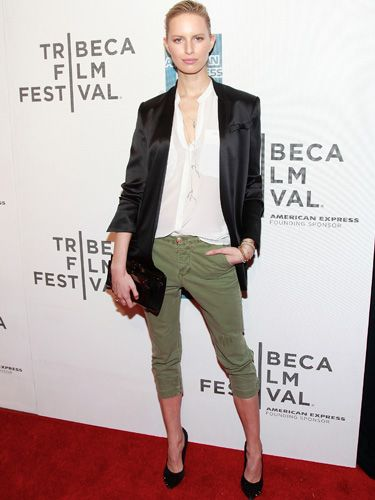 <p>Very elegant mix for Karolina Kurkova! She presents a casual chic look with her black satin suit and her tight and short khaki trousers which lengthen her never-ending legs. She looks smart and sophisticated not wearing much but playing with the sizes and neatly pulling her hair back</p>