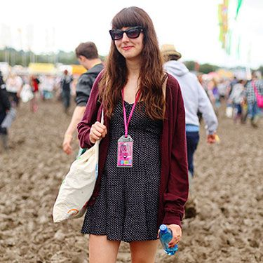 <p>Danielle donned a playsuit from Urban Outfitters for her Glasto experience and kept the sun out with a pair of Penelope Pitstop style sunglasses</p>