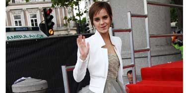 <p>Emma Watson made her way up the red carpet in Trafalgar Square in an enormous princess dress by Oscar de la Renta topped with a white jacket by Antonio Berardi</p>