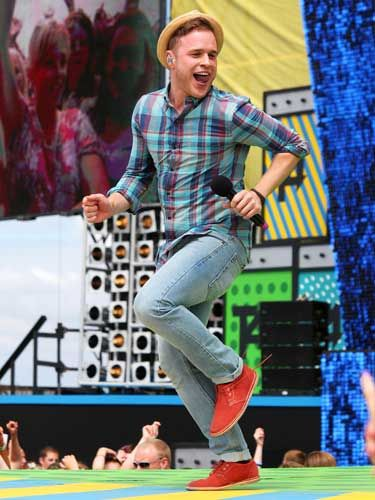 <p>Cheeky chappy Olly Murs was all grins and giggles as he bounced around the T4 stage </p>
