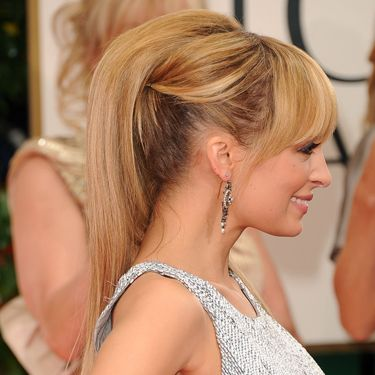 "<p>Nicole Richie made an uber-glamorous appearance on the red carpet for the Golden Globe Awards in an alternative high ponytail. The gorgeous updo featured a bouffant piece on top, twisted sides and Nicole's signature blunt <a href=""http://www.cosmopolitan.co.uk/most-wanted-fringes-79218?click=main_sr#fbIndex1"" target=""_blank"">fringe</a>. It's a look we want!</p>"