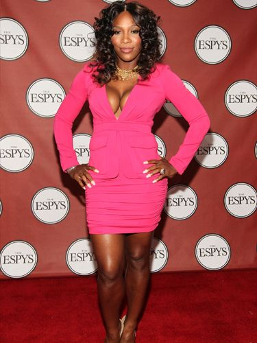 Wowzers! Serena Williams stood out from the crowd not only with her figure-hugging neon pink suit, but also that major cleavage! The tennis player looked worlds away from the court in her glam look as she showed off her assets.