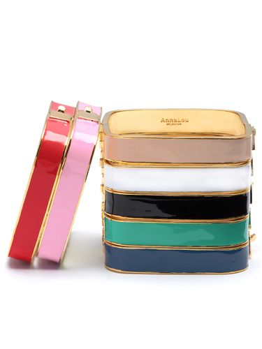 """<p>Whoever said squares were boring? Wear these fab enamel bangles alone for a simple, sophisticated look, or stack them if you can't choose a favourite!</p> <p>Square bangle, £30, <a href=""""http://www.annalouoflondon.com/productdetails.asp?id=3222&IG=1129 """" target=""""_blank"""">Annalouoflondon.com</a> </p>"""