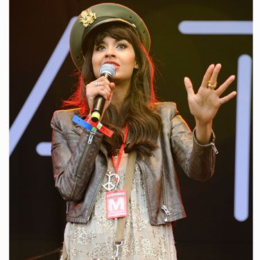 T4 presenter Jameela didn't let the weekend's showers dampen her desire to dress to impress at Lovebox festival. She donned a sequin embellished mini dress with brown leather jacket and finished off the look with a military cap and khaki bag. This is a lesson in festival dressing!