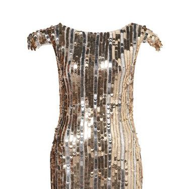 "<p>You are bound to stand out in the crowd in this silver and gold sequin dress. It's also a steal. Get in QUICK before it goes!!!</p><p>Now £40, Was £125, <a href=""http://www.topshop.com/webapp/wcs/stores/servlet/ProductDisplay?catalogId=33057&storeId=12556&productId=2370499&langId=-1&sort_field=Relevance&categoryId=217219&parent_categoryId=217217&pageSize=20&siteID=0RpXOIXA500-phcvfm_7KwJvdw4RfQsGUQ&cmpid=ukls_deeplink&_$ja=tsid:19906