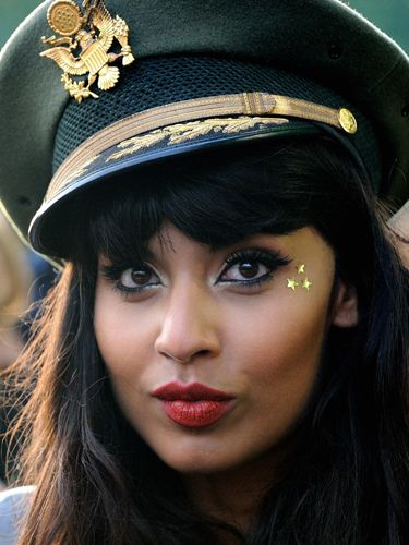 <p>Keeping her military cap the main focus, Jameela Jamil kept her makeup simple at Lovebox this year by just adding a few star stickers for a simple but fun look</p>