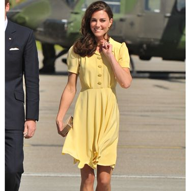 <p>It was a rather different story when Catherine, Duchess of Cambridge arrived in Calgary. She chose a prim canary yellow frock with nude court shoes and a box clutch</p>