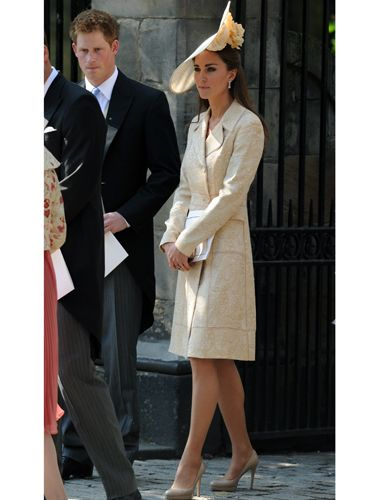As a guest at Zara Phillips' wedding to Mike Tindall, Kate kept a low profile in a summery nude ensemble. Her cream brocade coat by Jane Troughton (worn for the first time back in 2006 at Laura Parker Bowles' wedding) concealed her dress but all eyes were on her statement floral hat. Bloomin' lovely