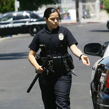 <p>Ugly Betty, is that you? We always knew she was a do-gooder but never thought she'd become a cop… Of course, it's just America Ferrera filming another role, which is in the upcoming release End of Watch. It also stars Jake Gyllenhaal - can't wait! </p>
