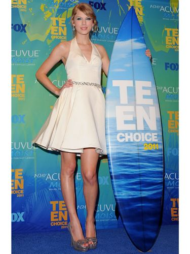 The dominant trend at the 2011 Teen Choice Awards, as demonstrated by Taylor Swift, was the little white dress. The singer's halterneck skater-skirted number by Rafael Cennamo looked sweet but chic paired with vintage-style silver accessories