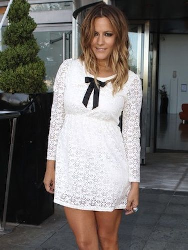 Xtra Factor host Caroline looks fresh in soft white lace, sporting a hefty cocktail ring and surf-chic hair, which stop this ensemble being too pretty-pretty.