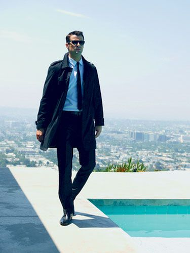 Clothing, Eyewear, Sleeve, Human body, Textile, Outerwear, Jacket, Sunglasses, Collar, Style,