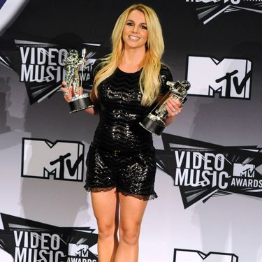 <p>Brit rocked a sequined LBD by Moschino with some tough Gina booties</p>