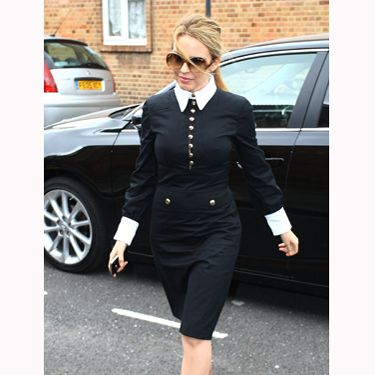 <p>With a collar and cuff that Karl Lagerfeld himself would be proud of, Kylie works this elegant 60s look. Wearing it with some oversized glasses this is one powerful outfit</p>