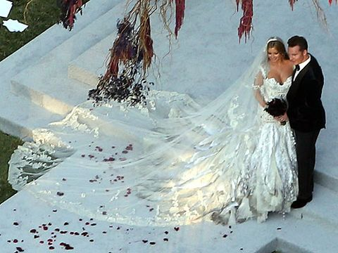 <p>Wills and Kate ain't got nothing on Holly Valance and Nick Candy in the lavish wedding stakes. The Australian actress said 'I do' to billionaire fiancé Nick in front of 300 guests including Simon Cowell in Beverley Hills.</p> <p>The 29-year-old bride wore an extravagant white and silver J'Aton Couture gown with vintage-style lace veil – check out the train on that! New hubbie also looked dapper in a Dolce & Gabbana suede tux. The wedding appaz stretched over three days and was so exclusive we could only get this helicopter vue pic.</p>