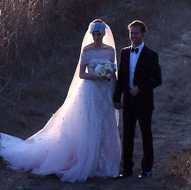 <p>Well she kept that one quiet! Anne Hathaway wed fiancé Adam Shulman in a super private ceremony in California on Saturday night, in front of 150 guests. The 29-year-old actress wore a gorge custom Valentino gown - natch. She accessorised with a veil and quirky headdress to cover her pixie hair - cut short for her role in role in upcoming film Les Mis. Her jewellery designer hubbie looks totes in love with her in this pic, n-aaawww.</p>