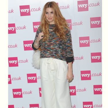 "<p>Whitney Port will be selling her own clothing line, Whitney Eve on <a href=""http://www.very.co.uk/web/en/celebrity-style.page"">very.co.uk</a> from October and came to London to show Fearne Cotton support at her show. She worked the 70s trend in these super wide white flares and check out her fluffy bag!</p>"