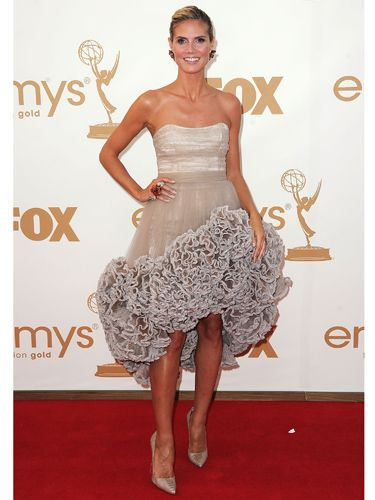 <p>Heidi Klum decided bigger was better this year, opting for a hugely ruffled nude gown by Christian Siriano. How best to play down this look? Simple Louboutins and a classy up-do</p>