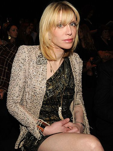 Actually forget Lindsay Lohan, the original hot-mess has arrived! Courtney Love took her place at the Roberto Cavalli show. We have to say, she's looking pretty good!