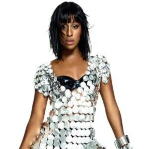 """While the X-Factor contestants join the judges in their houses around the globe, previous winner Alexandra Burke has happiness written all over her face. A new campaign to raise money for <en>Save the Children</em> sees the pop sensation reveal her most cherished possessions as part of a unique piece of word art to be projected onto the National Theatre.  Using a clever, free app, members of the public can also have their own photos transformed into word art and projected onto the famous landmark. All they need to do is visit www.facebook.com/aviva to submit their words and picture. Every time somebody uses the app, Aviva donates £2 to <em>Save the Children</em>. Aviva will also be setting up a pop up photo studio outside the theatre where people can have a free makeover and exclusive fashion shoot with world famous photographers, Jillian Edelstein and Clive Arrowsmith, a judge on <em>Britain's Next Top Model</em>. Get involved at <A HREF=""""https://www.facebook.com/aviva"""" TARGET=""""_blank"""">Facebook.com</a>"""