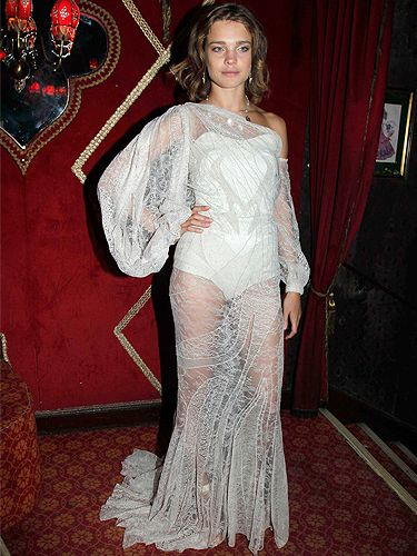 Model Natalia Vodianova looked ravishing in Givenchy Haute Couture at Carine Roitfeld's vampire themed dinner last night during Paris Fashion Week. The cream lacy layer of fabric was swathed beautifully across a white bodice underneath. Natalia left her makeup pared down and simple and let her legs catch the eyes