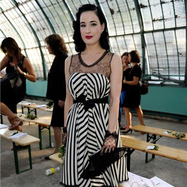 Burlesque Dita Von Teese was in Paris yesterday for the front row of Alexis Mabille Ready to Wear Spring/Summer 2012 with beau Louis-Marie de Castelbaja. She mixed monochrome stripes and lace more stylishly than anyone else ever could!