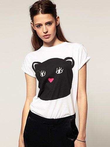 """Cats are everywhere right now in the world of fashion! We blame Victoria Beckham and her cat-print frock. Get on board the trend by wearing this cat print t-shirt from ASOS. Miaow! <p>£18, <a href=""""http://www.asos.com/Women/"""">ASOS</a></p>"""