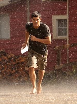 Oh, we do so love it when Jacob (Taylor Lautner) takes his top off. And, as fans of the <em>Twilight</em> series will know, this is usually precluded by some running in the rain. Here's a shot of him running in the rain. Guess we know those pecs will be making at least ONE appearance in this flick...